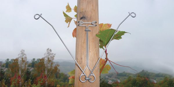 Stainless adjustable reinforcer for wooden poles